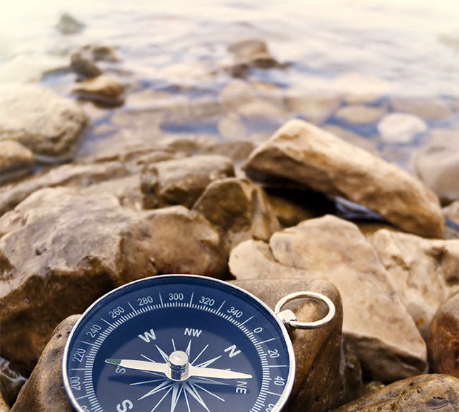 compass on the shore